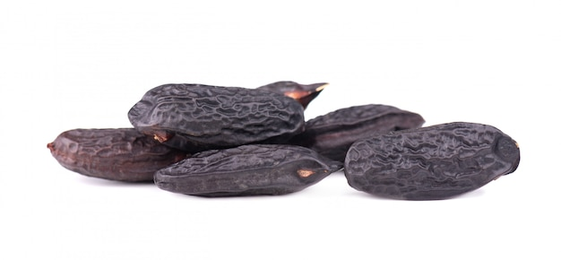Tonka beans isolated on white background