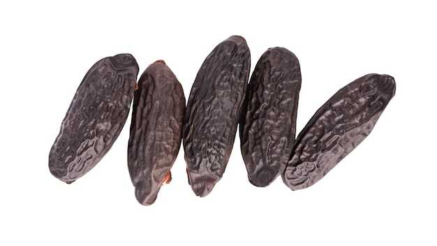 Tonka beans isolated on white. bean of dipteryx odorata, cumaru or kumaru.