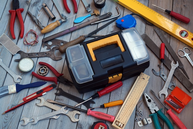 Tool box on wooden floor, view from above.