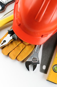 Tool for building a house or repairing an apartment, on a white background. the workplace of the foreman. theme of home and professional repair and construction.