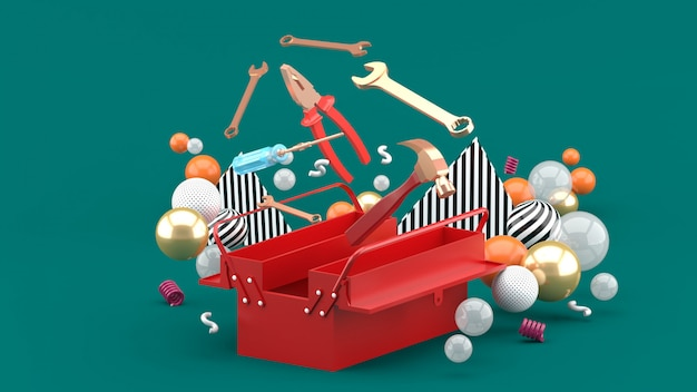 Toolbox amidst colorful balls on green. 3d rendering.
