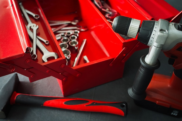 Toolbox with wrench tools drill hammer in workshop