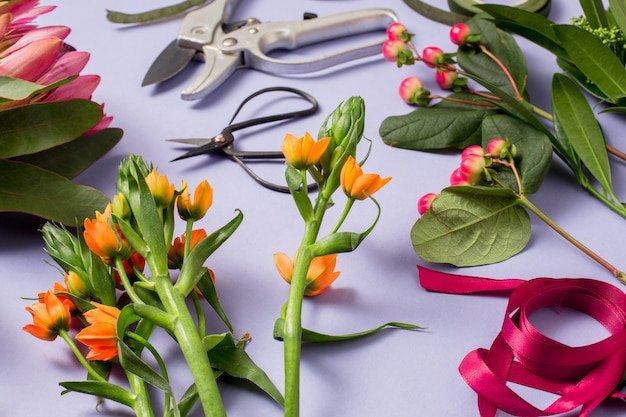 Tools and accessories florists need for making up a bouquet Free Photo