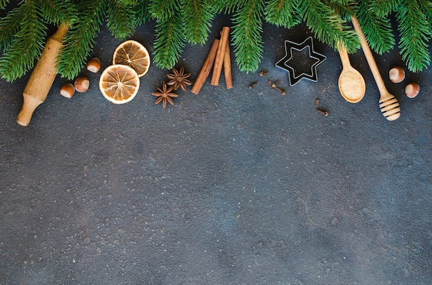 Tools for baking and fir branches on concrete.
