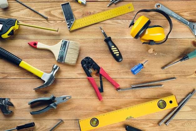Tools for building a house or repairing an apartment, on a wooden table. the workplace of the foreman. theme of home and professional repair and construction .