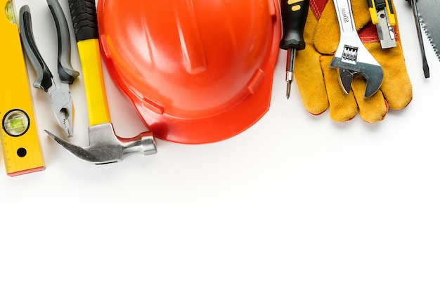 Tools for construction and red helmet