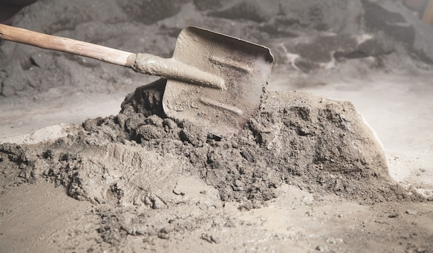 Tools on a construction site cement with shovel