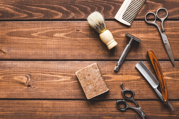 Tools for cutting beard barbershop top view on wooden background