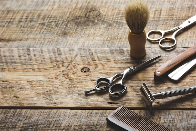 Tools for cutting beard barbershop on wooden background.