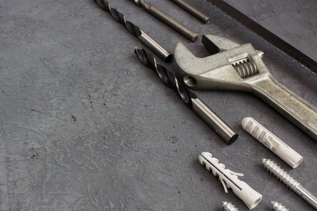 Tools on a dark  table with copyspace. set of joinery tool