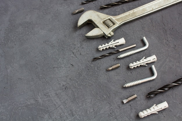 Tools on a dark table with copyspace. set of joinery tools