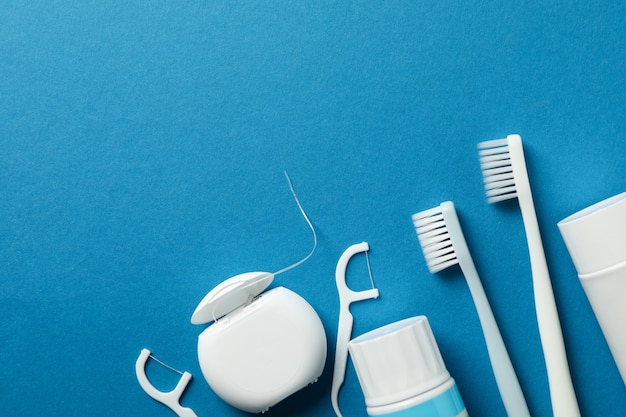 Tools for dental care on blue surface