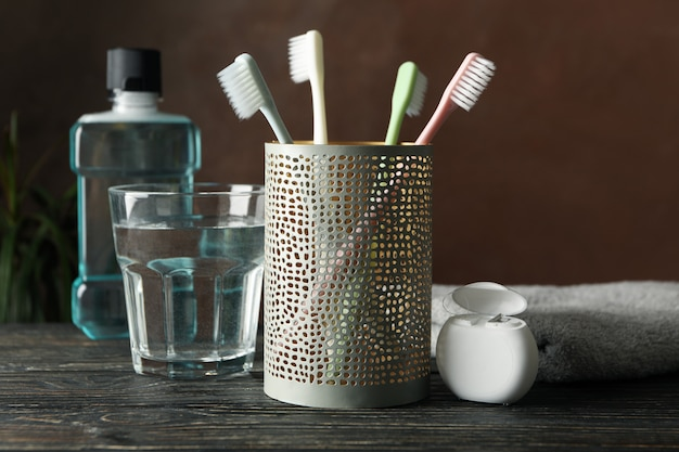 Tools for dental care on brown surface