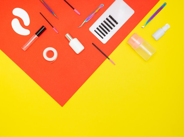 Tools for eyelash extension on a yellow background