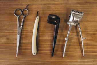Tools from barbershop on wooden background