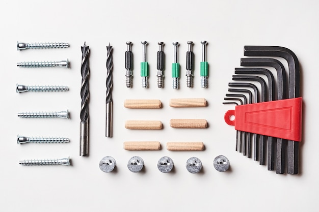 Tools for furniture assembly on a white background for mock up template design. view from above. flat lay