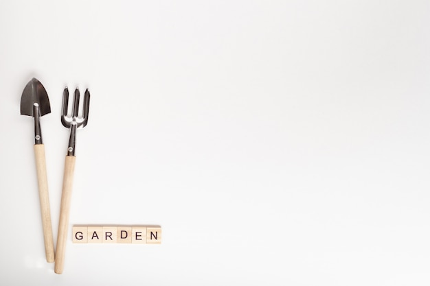 Tools for gardening at home and garden text made of wooden cube