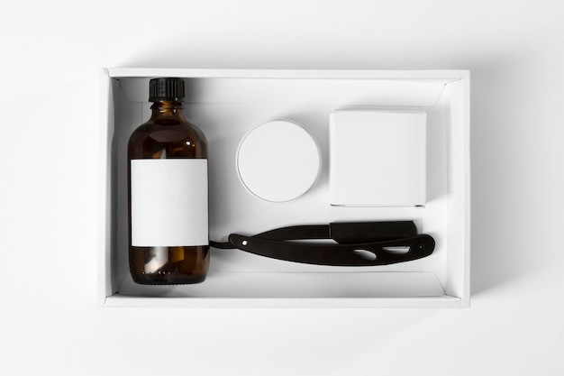 Tools for grooming beard in a white box top view