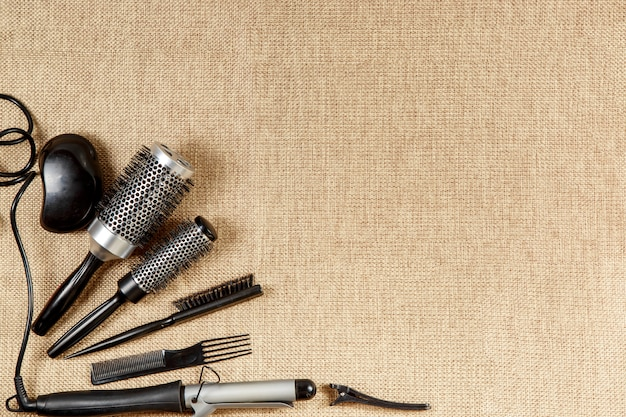 Tools hairdresser's top view on a beige background