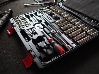 Tools in toolbox lying on the floor