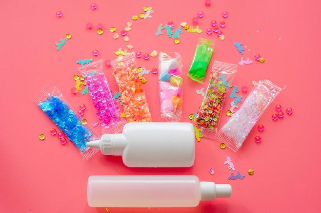 Tools and ingredients for making slime - glue, thickener, sprinkles, charms