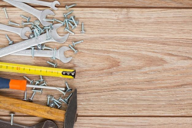 Tools kit border on wood