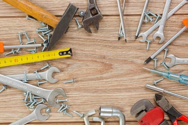 Tools kit frame on wooden planks
