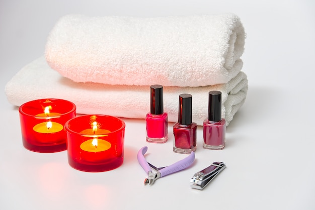 Tools of a manicure set on a white table. manicure kit at spa.