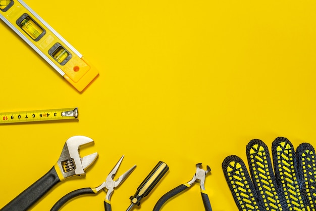 Tools for master builder on yellow background