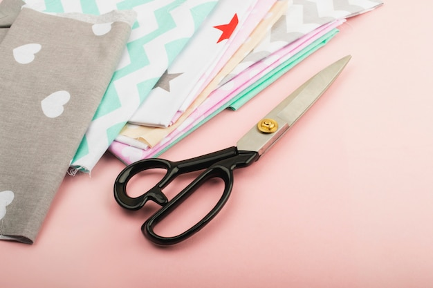 Tools and materials for sewing, scissors, threads, chalk, fabric. needlework, fashion and style.