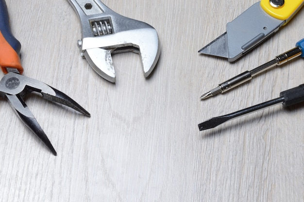 Tools for minor home repairs are on the countertop. view from above.