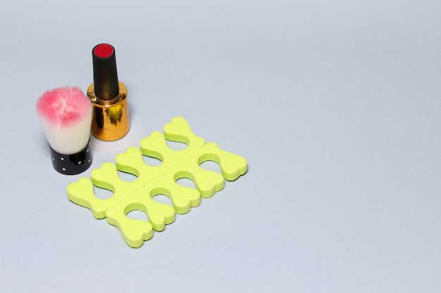 Tools for pedicure on a gray background