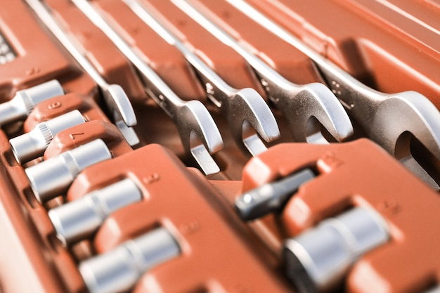 Tools for service and repair close-up in a brown box, metal equipment, wrenches for work.