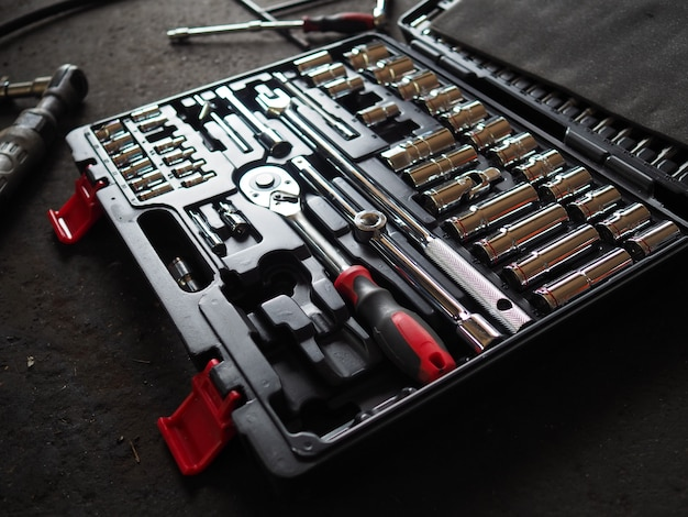 Tools in toolbox lying on the floor