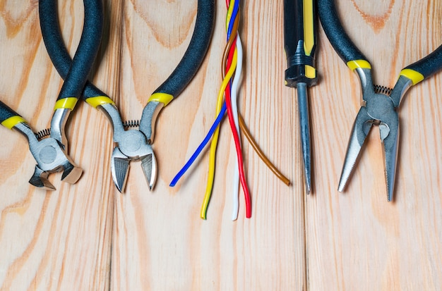 Tools and wire for electrician prepared before repair