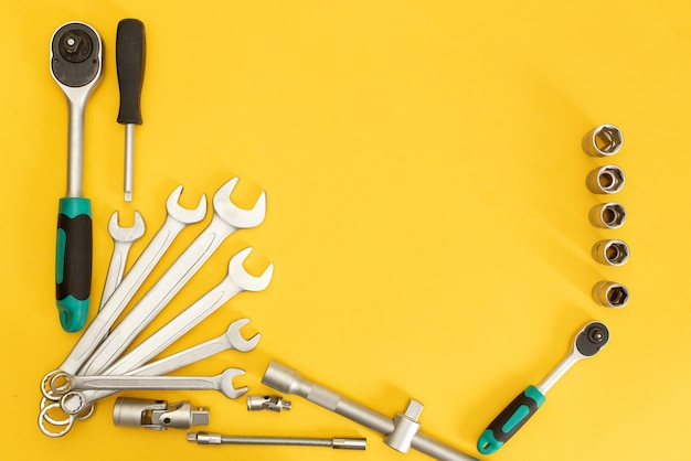 Tools on yellow background. flat lay