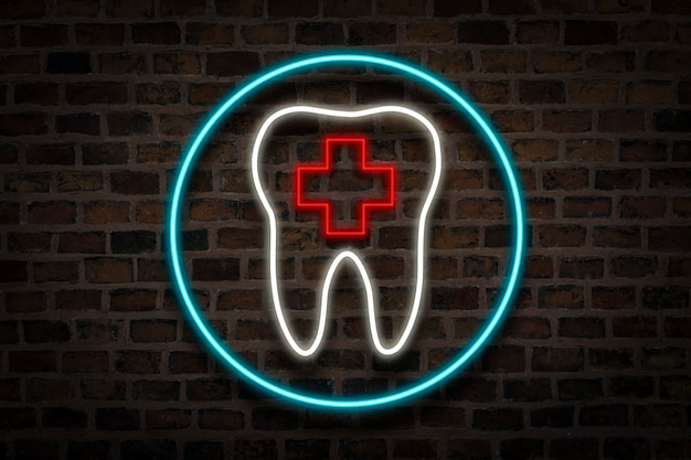 Tooth, neon sign on a brick wall. dental clinic concept, first aid.