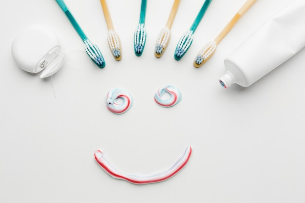 Tooth paste smile in flat lay