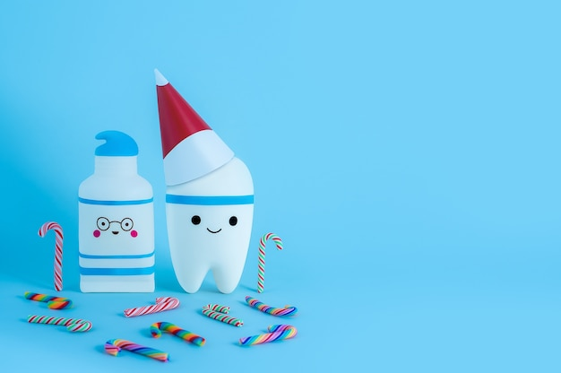 A tooth toy in a new year's hat next to a toothpaste surrounded by multi-colored candy canes