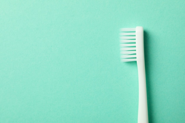 Toothbrush on mint surface