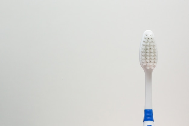 A toothbrush on white background close up image.