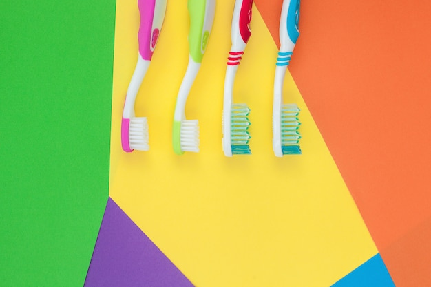 Toothbrushes on colorful bright background. family hygiene concept.