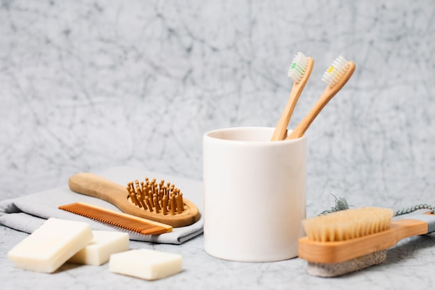 Toothbrushes in cup and natural hair brush