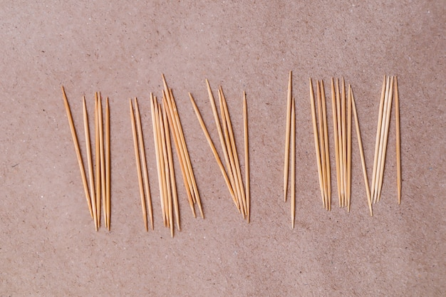 Toothpick on brown paper background