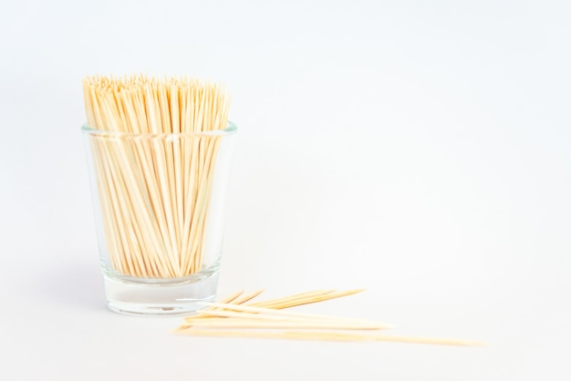 Toothpick isolated, toothpick from bamboo in a glass on white background