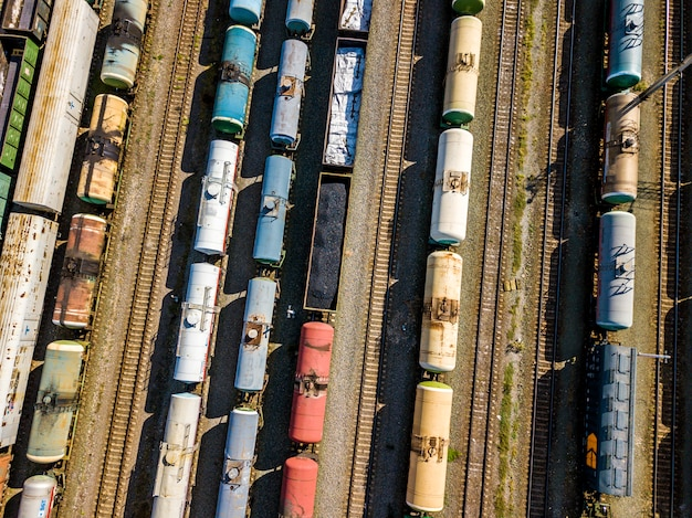 Top aerial view of coal carriage cargo train on a railroad station. transportation company f