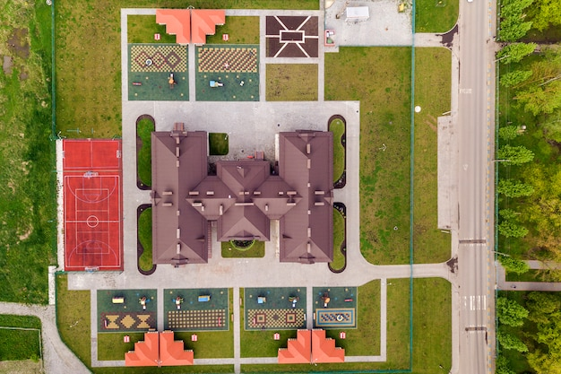 Top aerial view of new prescool building and yard with alcoves and green lawns.