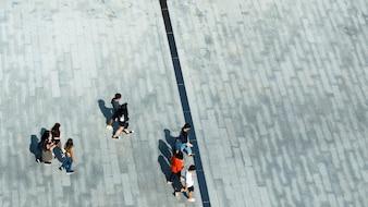 Top aerial view of people walk on pedestrian street city