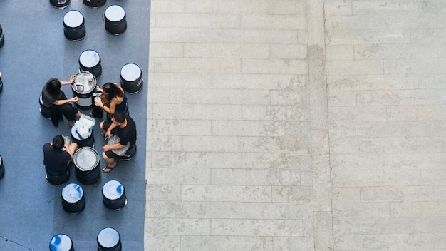 Top aerial view of people sit and talk picnic in pedestrian street