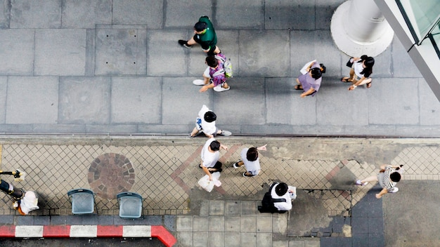 Top aerial view people walk on pedestrian street